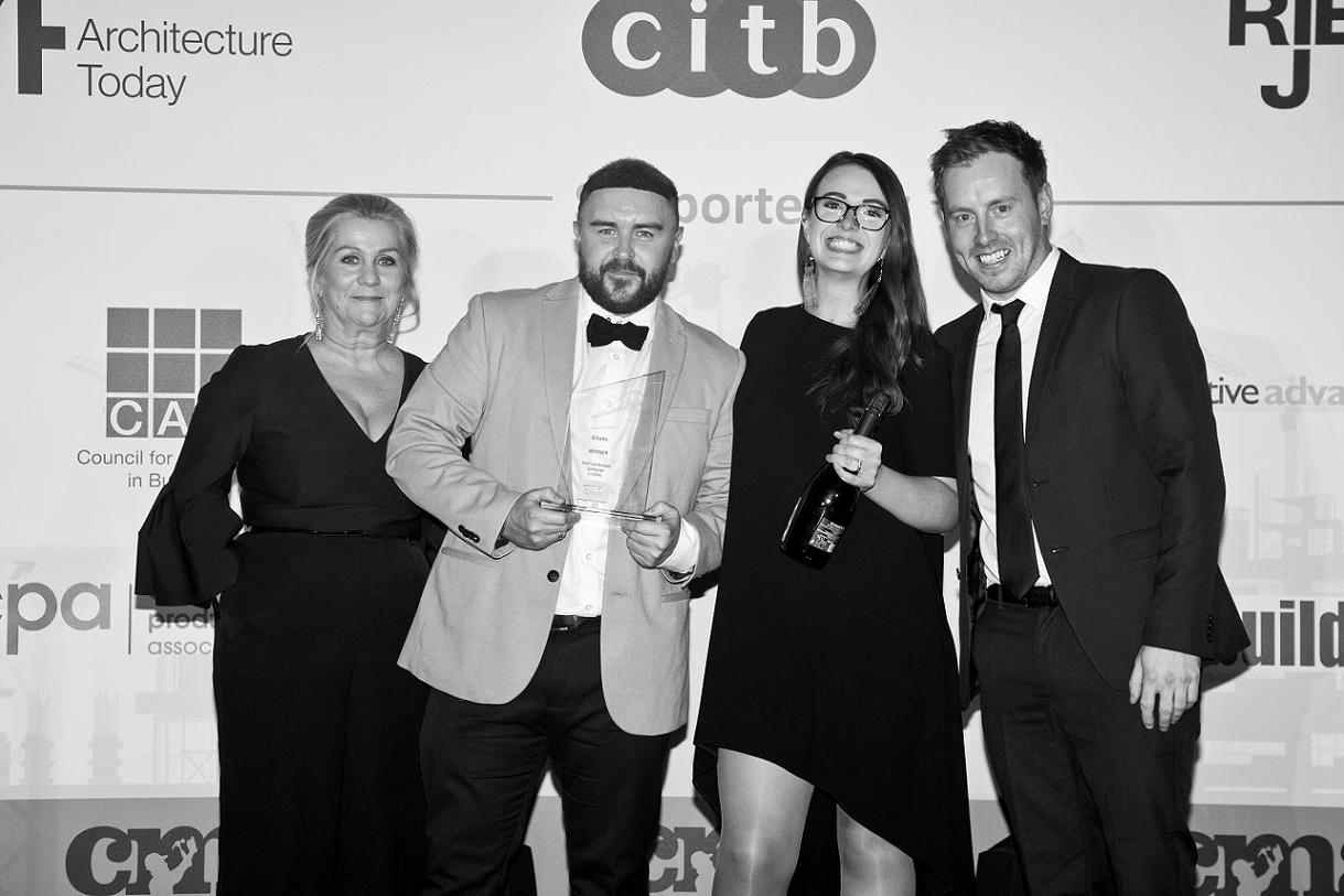 Elliotts' Graphic Designer, James Harris, and Marketing Executive, Emma McTaggart, collecting the award for Best Marketing Campaign under £25k at the Construction Marketing Awards