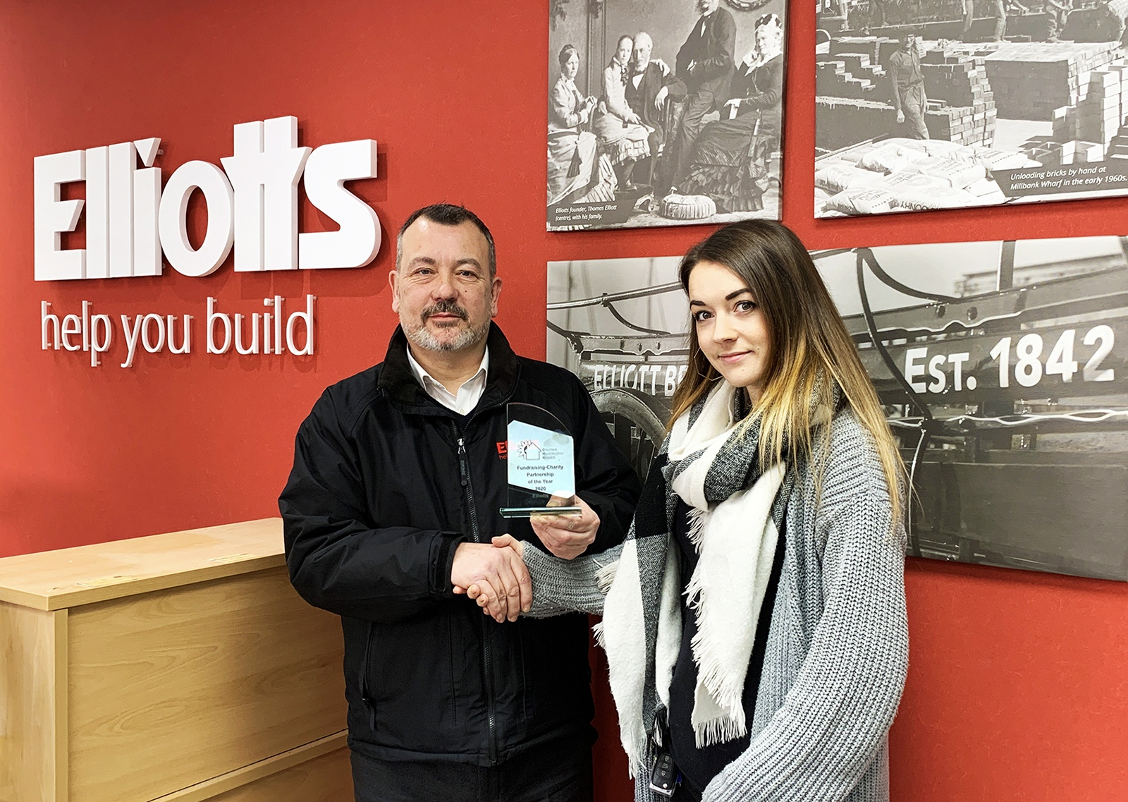 "Rachel Rawlings, presents the ""Fundraising Charity Partner of the Year"" award to Ed Butcher from Elliotts"