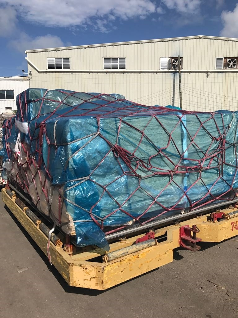 Supplies from Elliotts, along with other building donations, arrive in the Caribbean