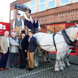 Tom Elliott and Stuart Mason-Elliott with longstanding customers, the Hammonds, outside head office